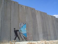 Escape...   by bansky - photo by marneri;  on the Abu Dis University side of a wall, Shaykh Jarrah, West Bank, Palestine