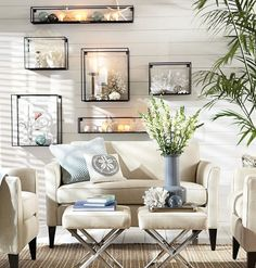 Give your beach finds formality with glass display cubes that you can hang on the wall. Featured at Beach Bliss Living: http://beachblissliving.com/beach-decor-pottery-barn/