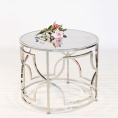 Low cocktail table, great for use in pairs in front of a sofa! Nickel plate finish with antique mirror top.