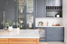 A dapper kitchen for a guy who loves to entertain—How one bachelor, two kitchens and three cabinetry styles add up to a handsome hub in this Richmond, B., home. Kitchen Cabinets Pictures, Blue Kitchen Cabinets, Kitchen Cabinet Doors, Ikea Kitchen, Kitchen Backsplash, Kitchen Countertops, Kitchen Furniture, Kitchen Dining, Kitchen Decor