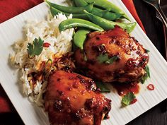 Asian-Glazed Chicken Thighs - Asian-inspired tasty glaze gives these chicken thighs a mahogany sheen. Rich thigh meat is higher in fat than lean white meat, so the thighs stay moist even when they're roasted without skin. Garnish with fresh cilantro and sliced green onions  http://www.myrecipes.com/recipe/asian-glazed-chicken-thighs