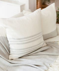 The striped alpaca pillow is a simple striped pillow that fits into any corner of the home. Super-soft alpaca is handmade in Peru with a subtle texture for. Fluffy Rug, Fluffy Pillows, Diy Closet Doors, Boho Cushions, Accent Wall Bedroom, Modern Essentials, Bedroom Paint Colors, Subtle Textures, Handmade Home Decor