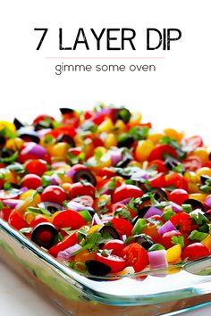 This classic 7 Layer Dip recipe is made with fresh and simple ingredients, and it is always a crowd-pleaser!! | gimmesomeoven.com