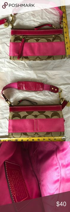 Coach small bag with strap Beautiful tan monogram Coach bag with pink. Bag shows some wear not noticeable. Smoke free/pet free home. No trades. I only deal through Poshmark. Coach Bags Shoulder Bags