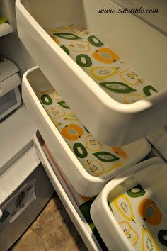make cleaning your fridge much easier with placemats on shelves and cut placemats for the door.  so doing this this weekend!!!