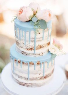 Two tier semi naked wedding cake decorated with blush flowers + blue icing #weddingcake #cake #seminakedcake #nakedcake