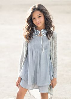 This two-tiered gray ruffle dress has pin-tuck details at the neck and lace embellishment at the shoulders. A cute addition to any fashionista's wardrobe! Little Girl Fashion, Kids Fashion, Diana, Bohemian Kids, New Girl, Ruffle Dress, Fashion Forward, What To Wear, Personal Style