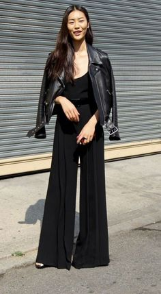 A leather jacket lends an edgy and chic touch to a jumpsuit and will keep out the chill of fall nights as seen on LA COOL & CHIC.