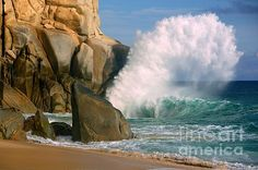 Mother Nature creates beautiful sandy beaches while sculpting rock cliffs with relentless repetitive thundering blows of turquoise ocean waves, and then offers a brief moment to gently soften the turmoil with white frothy bubbles. Copyright image by PCWitz, available for purchase. patrick-witz.artistwebsites.com