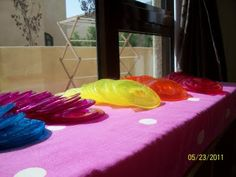 Rainbow Suncatcher: Melted plastic cups! Would be great for the light table too!