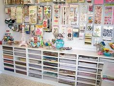I should do this in the basement. Nice organization. Love the cupcake holder that holds tins with buttons!  Her blog also has great ideas for cards and scrapbook pages.