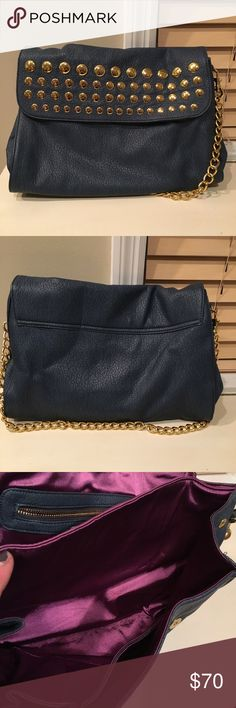"""NWT Duex Lux Shoulder Bag Blue Deux Lux shoulder bag with gold rivers and gold chain strap. Purple satin interior with 2 sections. Flap closure with 2 magnetic snaps. The shoulder chain is very light and won't hurt your shoulder. 10"""" H x 15"""" L x 6.5"""" W Deux Lux Bags Shoulder Bags"""