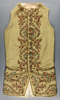 Waistcoat, probably England, 1740-1750s. Olive-green ribbed silk with chenille silk and silver metal thread embroidery in chain stitch.