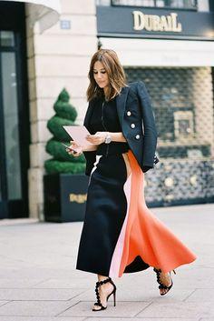 Christine Centenera in a black blazer + black zip-up sweater + colorblock midi skirt + ankle-strap heels