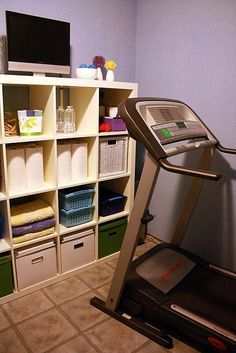 Basement workout room. I like the shelf for storage/display