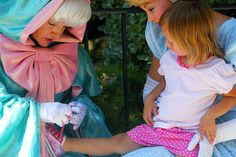 Fairy Godmother tying a little girl's shoe. This is adorable Little Girl Shoes, Girls Shoes, Little Girls, Tie Shoes, Your Shoes, String Of Pearls, Fairy Godmother, Scrubs, Ruffle Blouse