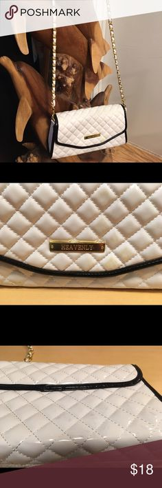 Quilted Patent Leather White beauty. Has a little discolor on the front and back. Nothing to distracting.  Sold as is Heavenly Bags Shoulder Bags