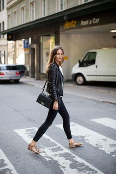 Leather jacket and leopard flats and a black chanel boy bag