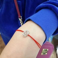 Cord bracelet with sterling silver khamsa (hamsa) charmKhamsa is a protective palm-shaped amulet also called Fatima's hand.Hamsa protects again evil's eye and we recommend to wear it on a red string to increase the effect.Amorem. Sterling silver. Handmade. Features adjustable cord.