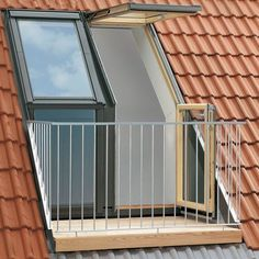 This VELUX roof terrace window system opens to the left-hand side with a two-window triple glazed configuration. The wide x high VELUX roof te. design VELUX Twin Roof Terrace L/H for Tile GEL 158 x