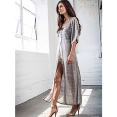 """Dazzle"" Silver High Low Maxi Top / Duster Silver high low button front top. Also can be layered as a duster. Available in SILVER and LATTE. This listing is for the SILVER. Runs true to size. Brand new without tags. NO TRADES. Bare Anthology Tops"
