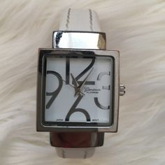 "🔴2/$10 3/$14 OR FREE WPURCHASE Watch White Silver Watch white faux leather band with silver around face.  Hinge Closure.  Gently used, mint condition. Needs battery. Stainless steel back. Circumference measures 7.5"" but is hinge closure *last pic.  Great item to add to a bundle 😊. Or free w purchase, just comment & I will create you a bundle 😀 Charming Charlie Accessories Watches"