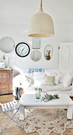 beach cottage coastal vintage decor - wicker casual pendant light, vintage mirror wall, jute rug, french cafe chair, old thrifted table, sea trunk (thrifted from garage sale), vintage second-hand door found on side of road   #beachy #beachhouse #coastaldecor