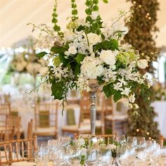 Tall candelabras were topped with roses, hydrangeas and lush greens.
