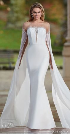 Simple and unique mermaid wedding dress with long sleeves and deep v-illusion neckline | Nicole Milano Wedding Dresses 2021 Collection - Belle The Magazine #weddingdress #weddingdresses #bridalgown #bridal #bridalgowns #weddinggown #bridetobe #weddings #bride #dreamdress #bridalcollection #bridaldress #dress See more gorgeous bridal gowns by clicking on the photo