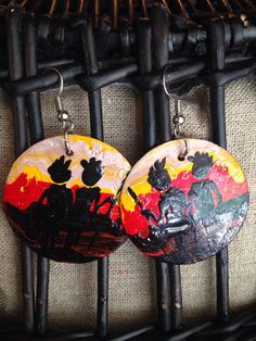 These beautiful hand made earrings by Davis Muwumba using hammered down recycled bottle caps which he then painted with beautiful African images.
