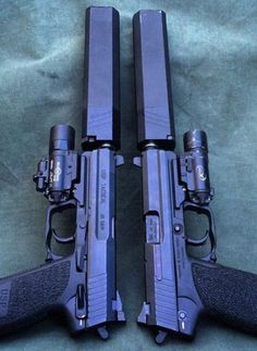 USP Tacticals in and with SureFire lights and SilencerCo and caliber Osprey suppressors. Hell yes ❤️ Weapons Guns, Guns And Ammo, Zombie Weapons, Rifles, Osprey Suppressor, Revy Black Lagoon, Fire Powers, Cool Guns, Tactical Gear