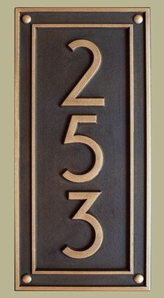 This prairie styled address plaque is custom carved and coated with copper or brass.