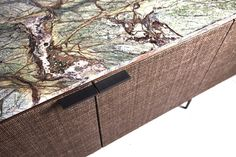 Cool long bar with nice woven fronts and marble top http://www.kikosalomao.com.br/pt/projetos/design/bar-living