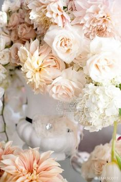 Ivory garden roses, blush and cafe au lait dahlias, white peonies. These are the flower colors I would like! :)