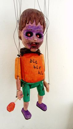 zombie boy with movein jaw. Wooden marionette.
