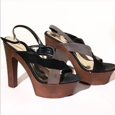 """Black & Brown Sandal Wooden heels with blacks and brown straps in X formation. Buckle and tab closure at the ankle. A couple of marks from wear but Gently worn. Very comfortable. 5 1/2"""" heel. 2"""" platform. Liliana Shoes Platforms"""