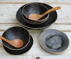 lovely black bowls with plates for soup or salad or cereal.... Laurie G Ceramics