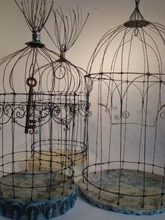 love these primitive wire bird cages!