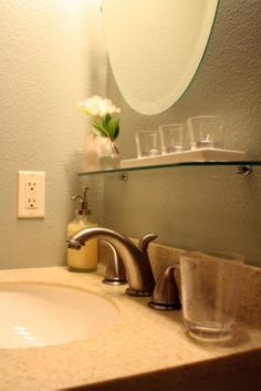 bathroom reno idea: glass shelf under the mirror
