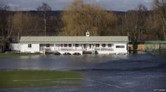 Along the banks of the River Thames, the pitch of Henley Cricket Club, in Henley-on-Thames, is under water.