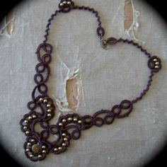 Tatted Lace Necklace - Trailing Scrolls - Chocolate Brown and Brass. $48.00, via Etsy.