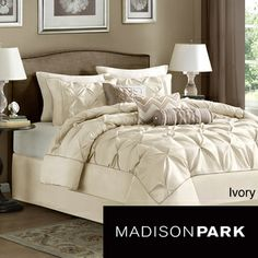 Update your bedroom beautifully with this ivory Madison Park Lafayette seven-piece comforter set. This contemporary comforter set is hypoallergenic and features a distinctive pieced pattern design mad