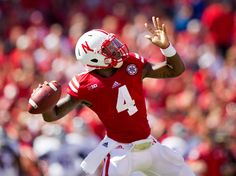 Husker quarterback Tommy Armstrong Jr. passes the ball against Florida Atlantic on Aug. 30, 2014. By: REBECCA GRATZ/THE WORLD-HERALD