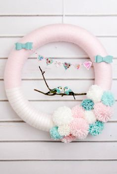 Hearts and Lovebirds Valentine's Day Wreath - a cute craft to make to add to your Valentine's Decor. All you need is a foam wreath, felt, yarn, a twig, two small love birds, and scrap fabrics.