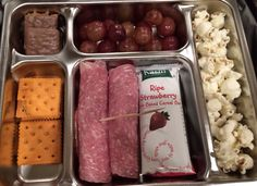 Meat and cheese roll ups, cereal bar, grapes, popcorn, PB crackers and a cookie!