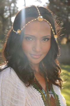 Cute girl in traditional Eritrean/Ethiopian dress and jewelry.