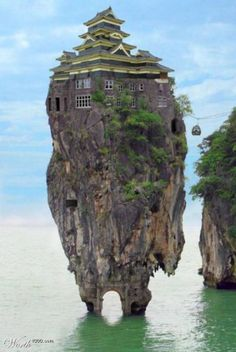 House on top of a BIG ROCK... IN THE OCEAN......
