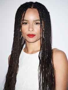 Zoë Kravitz shows off her cool girl style with her signature box braids and bold red lips