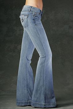 They remind me of my favorite jeans in high school, the ones I wore until they had holes in the knees. If I had only known I'd later be paying for jeans with holes already in them. Anyway, I love the hem, the back pockets, the low-rise, and the flare. They look perfect!.