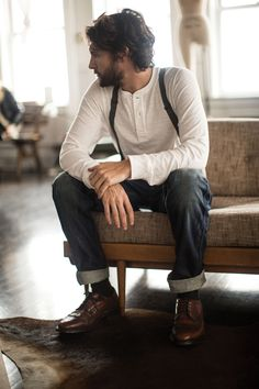 Shop this look on Lookastic:  https://lookastic.com/men/looks/white-henley-shirt-navy-jeans-brown-leather-brogues/491  — Navy Jeans  — Brown Leather Brogues  — White Henley Shirt